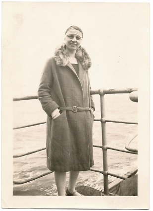 woman on boat with furry coat