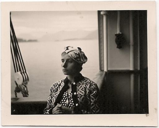 woman on boat wearing fancy hat