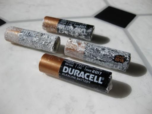 four defective duracell batteries