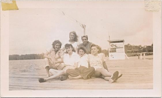six girls on the pier