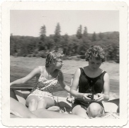 two girls on a motorboat